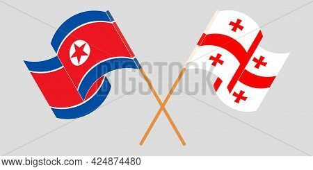Crossed And Waving Flags Of Georgia And North Korea