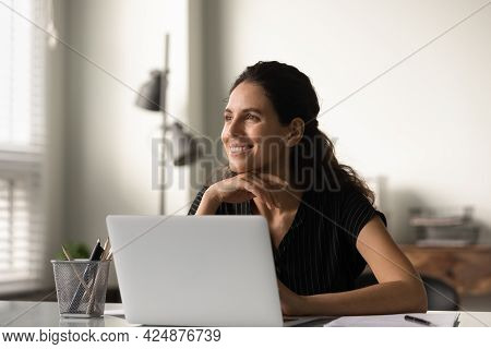 Smiling Woman Distracted From Computer Work Dreaming