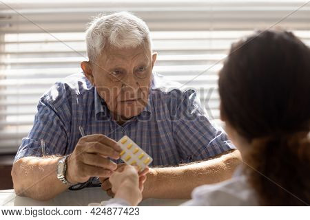 Old Male Patient Consult With Doctor About Medications