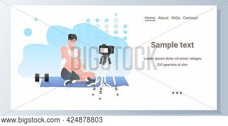 Male Fitness Trainer Recording Video Blog Using Camera On Tripod Live Streaming Blogging Workout Con