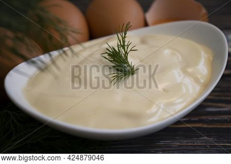 Mayonnaise, Egg, Dill On Wooden Background Homemade
