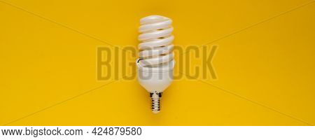 Classic Energy-saving White Lamp, With Efficient Power Use, Isolated On A Color Background