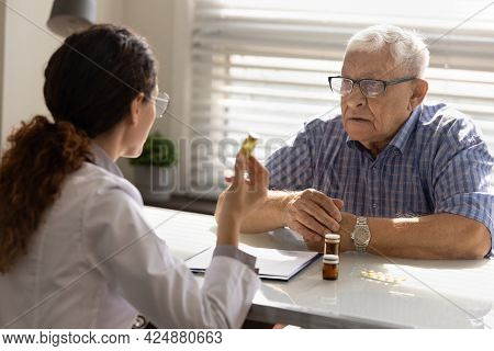 Female Doctor Prescribe Medications To Old Patient