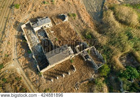 Aerial View Of Abandoned And Collapsing Animal Farm Building In The Field. Deserted Places Cyprus