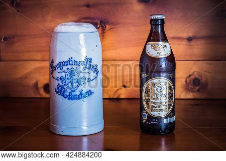 Munich, Germany - May 24 2021: Augustiner Edelstoff Bavarian Beer Bottle And Liter Stein Or Mug.
