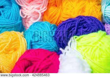 Multicolored Skeins Of Thread For Knitting, Background Texture.