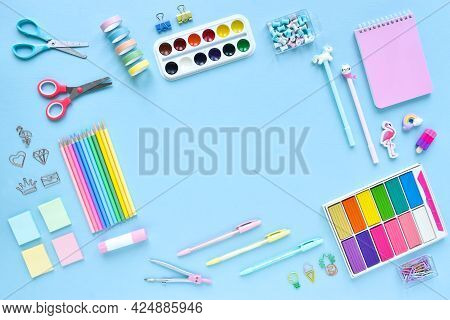 Background Of School Supplies In Pastel Colors On A Light Blue Background, Space For Text. Office Su