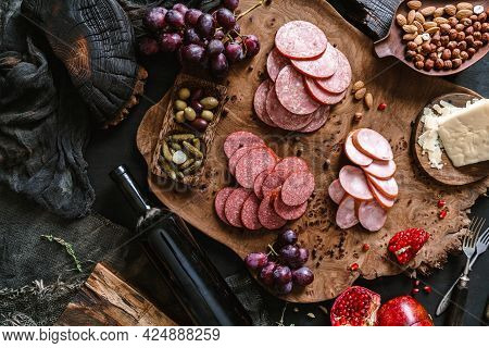 Antipasto Cold Meat Platter With Sausage, Ham, Salami, Decorated With Cheese, Fruits, Bottle Of Wine