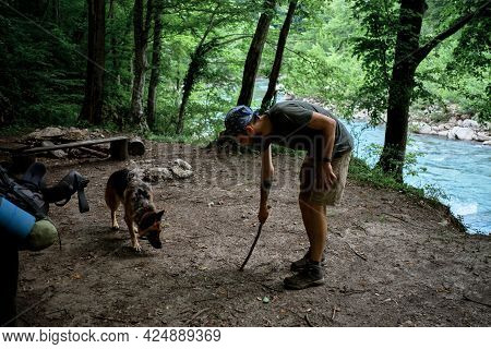 Young Handsome Caucasian Male Traveler With Bandana On His Head And Beard Draws Line On Ground With