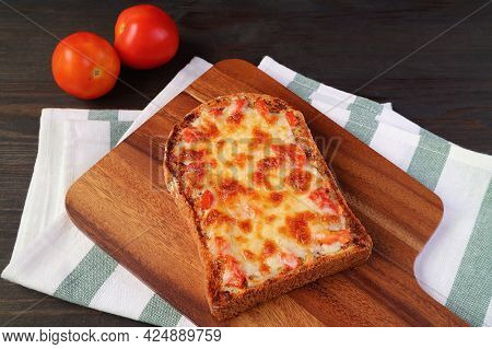 Fresh Baked Delectable Homemade Pizza Toast On Kitchen's Table