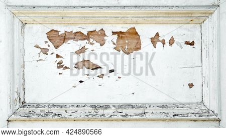 White Paints Cracks And Peels Away To Reveal The Wood Beneath. The Painted Surface Is Heavily Damage