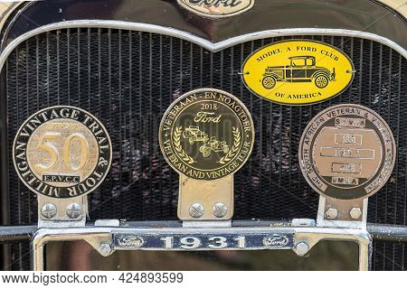 Villiersdorp, South Africa - April 12, 2021: Information Disks And Radiator Of A Ford Model A Vintag