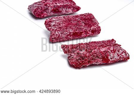 Bricks Of Frozen Grated Beets. Procurement Of Frozen Food. Semifinished.