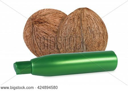 Shampoo Or Gel With Coconut Extract. Coconuts And Plastic Jar With Shower Gel Or Shampoo On An Isola