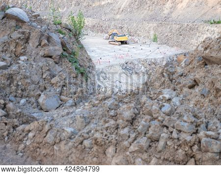 Track Type Loader Is Mining Stones In Opencast Mining Quarry. Heavy Machinery In The Open Pit, Excav
