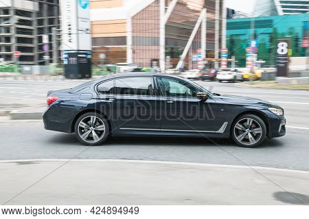 Moscow, Russia - May 2021: Black Bmw 7 Series G11 On The City Road. Fast Moving Car On The Street. V