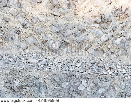 Detail Of A Stone Pit In Stone Quarry. Industrial Site, Granite Gravel Mining In Open Pit.