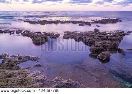Blue Hour (after Sunset) View Of The Mediterranean Sea Coast, With Abrasion Platforms, In Shikmona P
