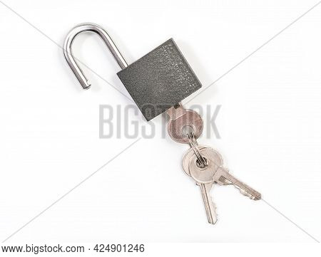 Lock And Keys. Closeup Of Opened Metal Padlock With Key Inside Isolated On A White Background. Macro