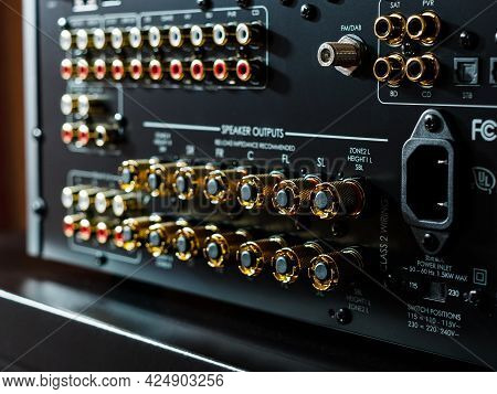 Moscow, Russia - May 23, 2021: Rear Part Of A Power Music Amplifier With Line-out, Speakers Inputs,