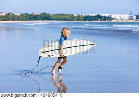 Happy Surf Boy - Young Surfer Run To Ride On Surfboard With Fun On Sea Waves. Active Family Lifestyl