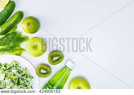 Green Diet, Natural Detoxification Vitamins. Healthy Plant Based Food On Light Grey Background With