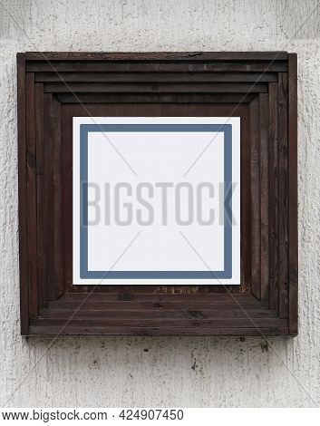 Old Brown Wooden Square Frame On Facade Wall