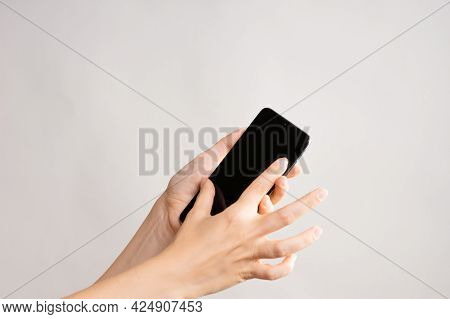 Use Mobile Apps, Scroll. Smartphone, The Female Hand Uses The Touchpad.