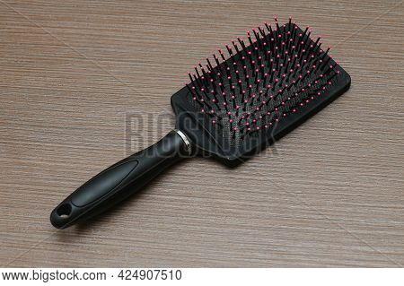Plastic Hair Brush Beauty Accessory On Brown Wooden Table