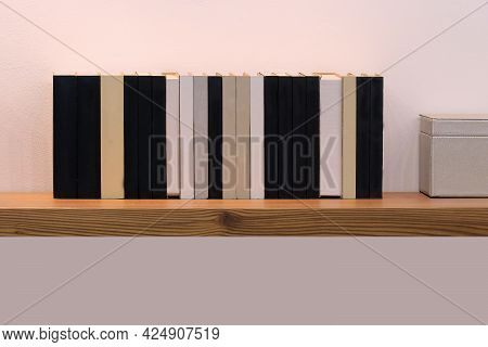 Old Vintage Hardcover Books In Row On Brown Wooden Shelf
