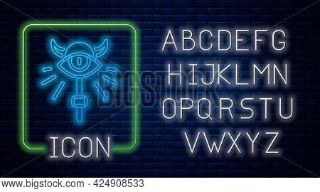 Glowing Neon Magic Staff Icon Isolated On Brick Wall Background. Magic Wand, Scepter, Stick, Rod. Ne