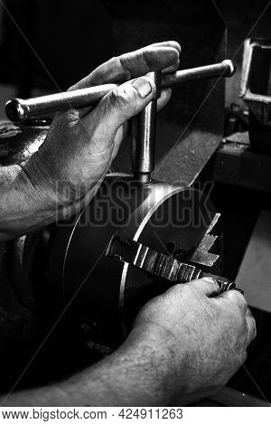 Black And White Image Of The Hands Of A Metalworker, Close-up