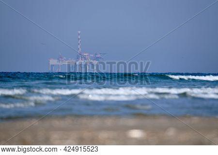 Ameland, Netherlands April 20, 2021-nam, Oil Rig, Offshore Platform With Beach, Sand And Surf. Natur