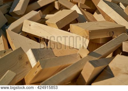Remains Of Building Material Made Of Wood On The Storage Yard For Processing In A Pellet Plant In Th