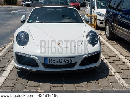 Campos, Spain; June 12 2021: White Porsche Convertible Parked In Parking Lot