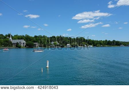 SKANEATELES, NEW YORK - 17 JUNE 2021: St. James Episcopal Church and homes on Skaneateles Lake in upstate New York.