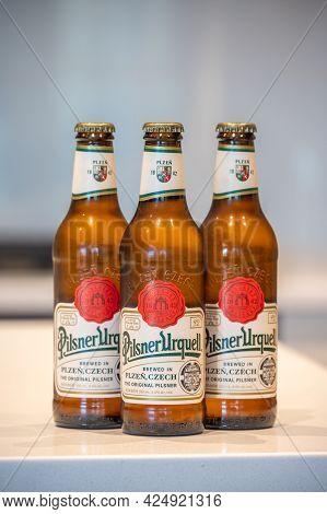 Calgary, Alberta - June 22, 2021: Pilsner Urquell Lager Beer Bottle In White Kitchen. Pilsner Urquel