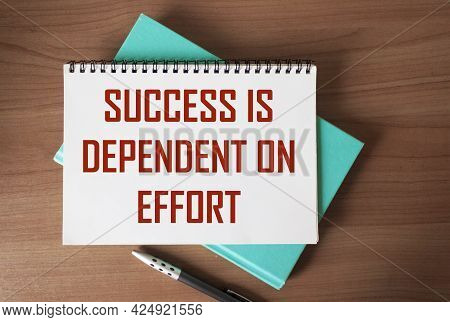 Text On Notepad: Success Is Depends On Effort. Motivational Quote
