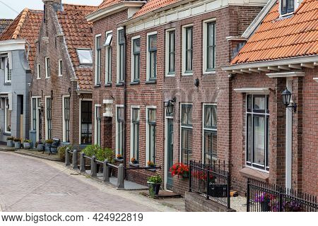 Row Of Old Dutch Houses In A Littel Village