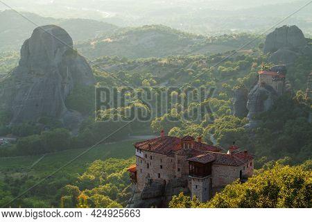 Meteora, Greece. Beautiful Rousanou Monastery In Dawn Sunlight