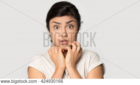 Portrait Of Scared Indian Woman Feel Frightened