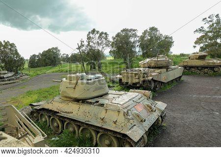 Several Old War Tanks In A Memorial Site.