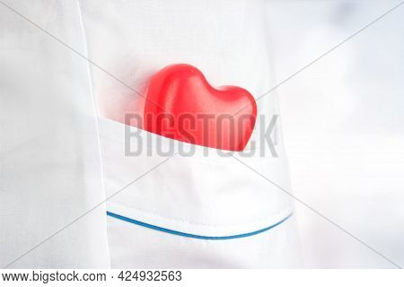 The Concept Of Medicine And Health Insurance. Rubber Heart In The Pocket Of A Medical Gown. Health C