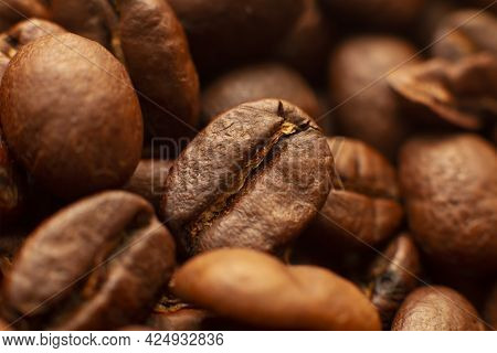 A Closeup Of Coffee Beans. Lots Of Roasted Coffee Beans