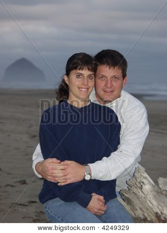 Happy Young Couple On The Beach