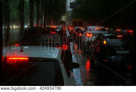 Bucharest, Romania - June 16, 2021: The Cars Are Waiting At The Red Traffic Light During The Rain On