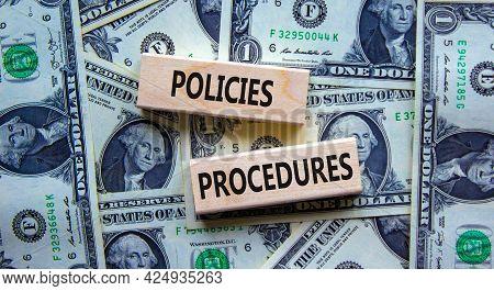 Policies And Procedures Symbol. Wooden Blocks With Concept Words Policies Procedures On Background F