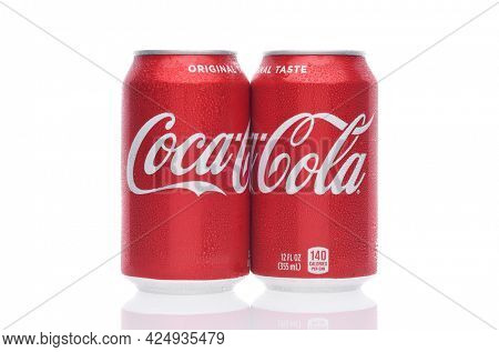 IRVINE, CALIFORNIA - 26 JUNE 2021: Two cans of Coca-Cola. Coke is the one of the worlds favorite carbonated beverages.