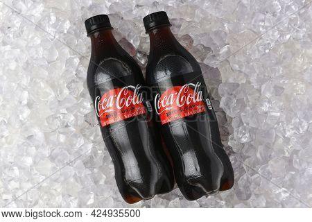 IRVINE, CALIFORNIA - 26 JUNE 2021: Two plastic bottles of Coca-Cola Zero in a bed of ice.