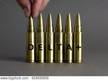 Covid-19 New Delta Plus Variant Symbol. Ammunitions Imitation With Words Delta Plus. Doctor Hand. Be